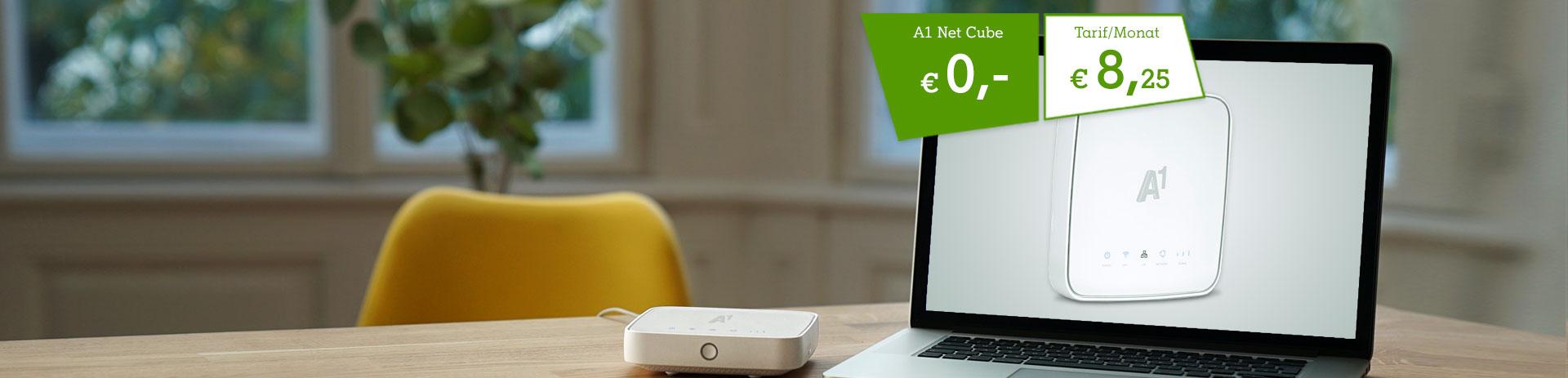 A1 Net Cube 2 um € 0,- auf einem Tisch neben einem Laptop. Tarif um € 8,25 pro Monat für die ersten 3 Monate.