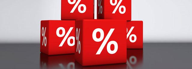 Grüne Würfel mit Prozentzeichen