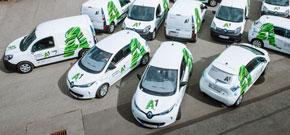 A1 Fuhrpark - weiße Autos  verziert mit grünen A's